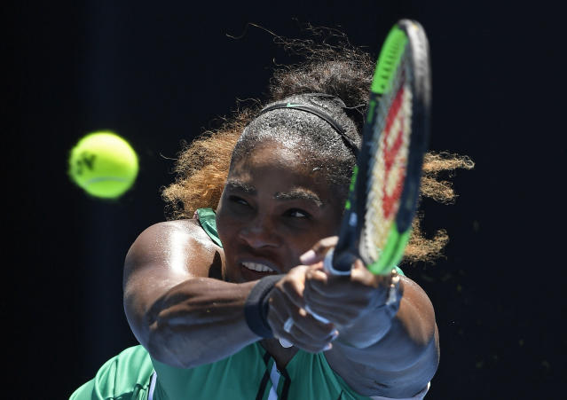 United States' Serena Williams makes a backhand return to Karolina Pliskova of the Czech Republic during their quarterfinal match at the Australian Open tennis championships in Melbourne, Australia, Wednesday, Jan. 23, 2019. (AP Photo/Andy Brownbill)