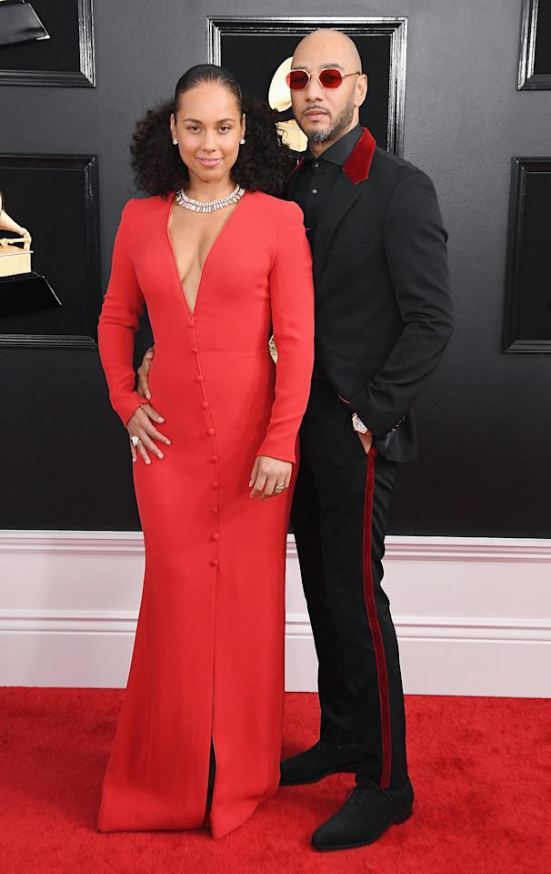 """<p>In her autobiographical book <a href=""""https://people.com/music/alicia-keys-swizz-beatz-love-story-details/""""><em>More Myself</em></a>, the mom-of-two opens up about now-husband Swizz Beatz whisking her off on a romantic trip to Hawaii, where he popped the question and she believes they conceived son Egypt, 9.</p> <p>""""'Open it,' Swizz said as he slid the box toward me. I lifted the cardboard flaps and looked inside to see several large canisters. 'I've always wanted you to be my canvas,' he whispered. The canisters were full of body paint, in every vibrant color imaginable,"""" she writes about a gift he presented her with during the getaway. """"Later, stroke by stroke in the shadows of dusk, he turned me into his masterpiece, covering me in swirls of yellows, reds and purples. Never have I experienced anything more sensual. Which is why, when I missed my period a few weeks later, I wasn't exactly surprised. As that winter gave way to spring, we relished two pleasures: the engagement and the pregnancy.""""</p> <p>The musicians are also parents to son Genesis, 5.</p>"""