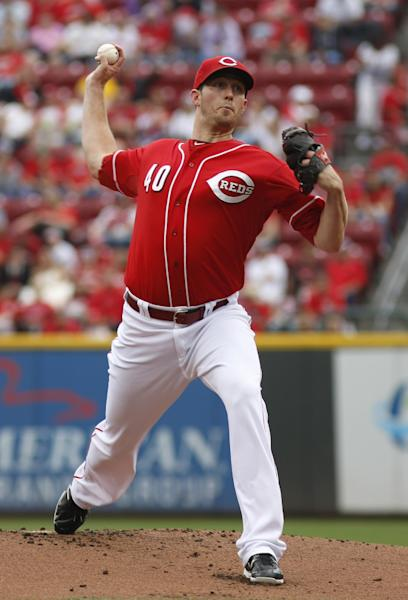 Cincinnati Reds starting pitcher Greg Reynolds throws against the Pittsburgh Pirates during the first inning of a baseball game on Sunday, Sept. 29, 2013, in Cincinnati. (AP Photo/David Kohl)