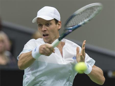 Tomas Berdych hits a forehand against Marin Cilic during their final match of the ABN AMRO tennis tournament in Rotterdam