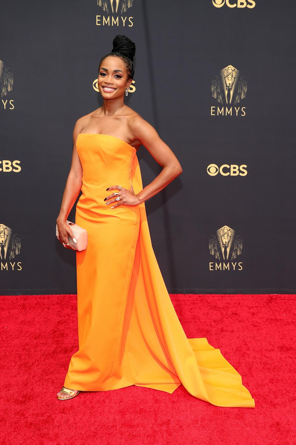 This tangerine strapless dress with a cape train by Christopher John Rogers is absolute perfection on the <em>Bachelor</em> star.