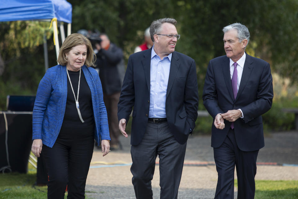 From left, Esther George, President and CEO of the Federal Reserve Bank of Kansas City, John Williams, President and CEO of the Federal Reserve Bank of New York, and Jerome Powell, Chairman of the Board of Governors of the Federal Reserve System walk together on Friday, Aug. 24, 2018 in Jackson Hole, Wyo. (AP Photo/Jonathan Crosby)