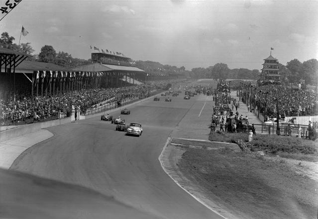 FILE - In this May 30, 1947, file photo, the pace lap of the Indianapolis 500 auto race is underway at the Indianapolis Motor Speedway in Indianapolis, Ind. Indianapolis Motor Speedway and the IndyCar Series have been sold to Penske Entertainment Corp. in a stunning announcement that relinquishes control of the iconic speedway from the Hulman family after 74 years. (AP Photo/File)