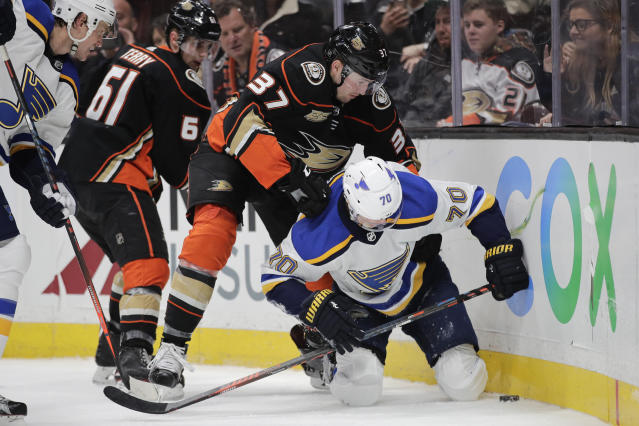 Anaheim Ducks' Nick Ritchie, top, shoves St. Louis Blues' Oskar Sundqvist, of Sweden, during the second period of an NHL hockey game Wednesday, March 6, 2019, in Anaheim, Calif. (AP Photo/Jae C. Hong)