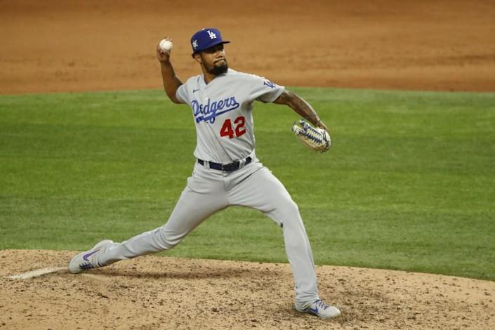 Los Angeles Dodgers relief pitcher Dennis Santana throws during the eighth inning of a baseball game.