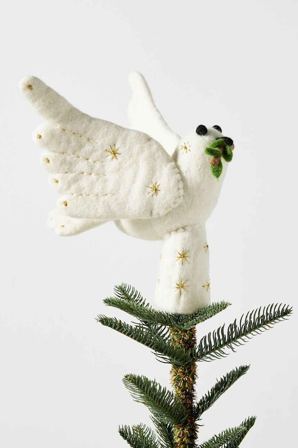 """<p>Complete any holiday tree with the delightful <a href=""""https://www.popsugar.com/buy/Felted-Dove-Tree-Topper-490480?p_name=Felted%20Dove%20Tree%20Topper&retailer=anthropologie.com&pid=490480&price=42&evar1=casa%3Aus&evar9=46615300&evar98=https%3A%2F%2Fwww.popsugar.com%2Fhome%2Fphoto-gallery%2F46615300%2Fimage%2F46615350%2FFelted-Dove-Tree-Topper&list1=shopping%2Canthropologie%2Choliday%2Cchristmas%2Cchristmas%20decorations%2Choliday%20decor%2Chome%20shopping&prop13=mobile&pdata=1"""" rel=""""nofollow noopener"""" class=""""link rapid-noclick-resp"""" target=""""_blank"""" data-ylk=""""slk:Felted Dove Tree Topper"""">Felted Dove Tree Topper</a> ($42) on top.</p>"""