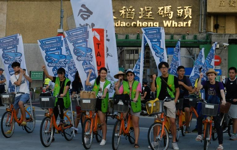 Pro-Taiwan independence activists demand a referendum as they ride through the streets of Taipei earlier this year. Protesters will stage another rally Saturday
