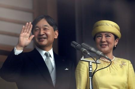 FILE PHOTO - Japan's Emperor Naruhito and Empress Masako greet well-wishers during their first public appearance at the Imperial Palace in Tokyo
