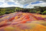 <p>The multicolored earth in Chamarel was formed when volcanic rock cooled at different temperatures. </p>