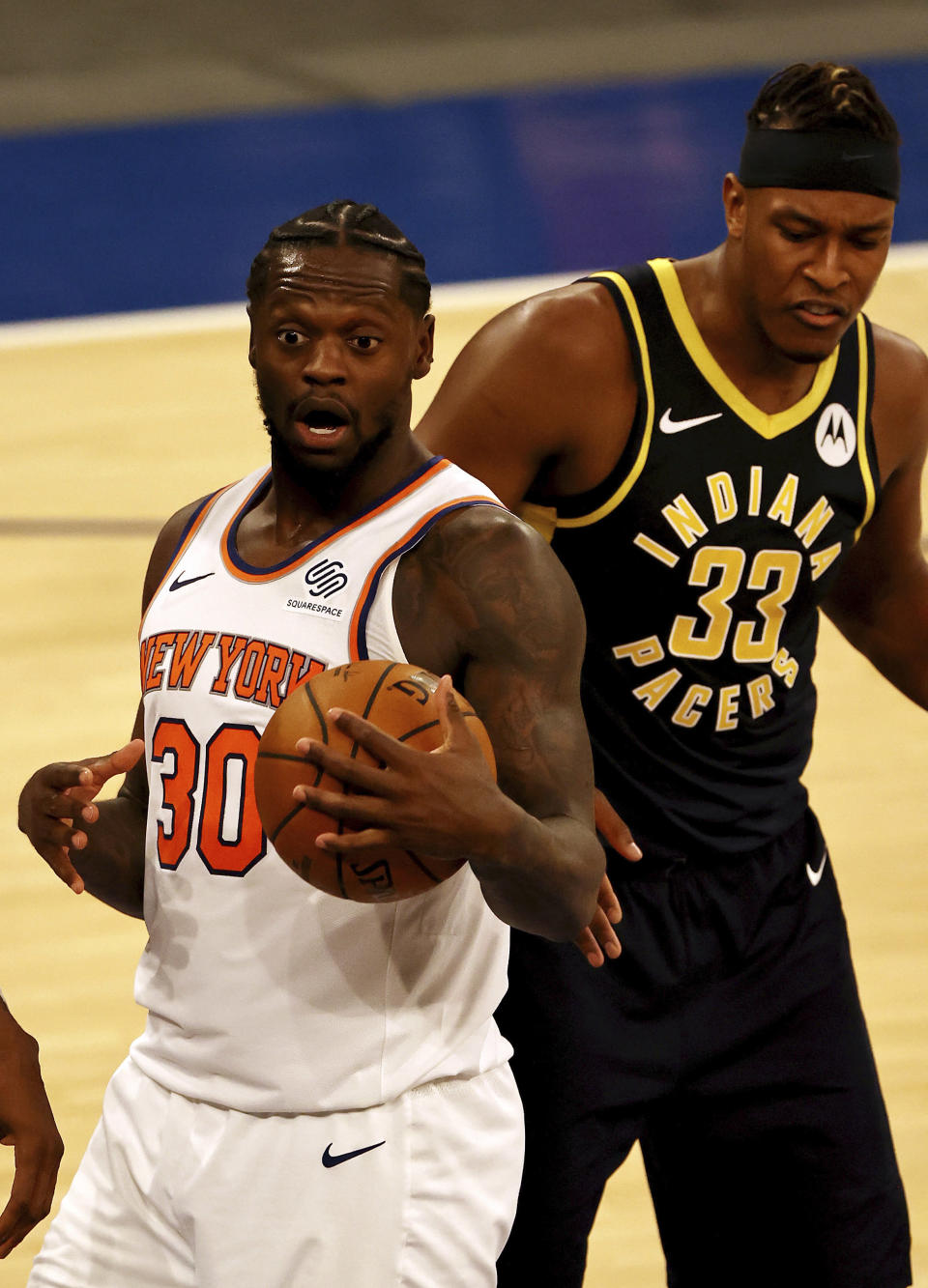 New York Knicks' Julius Randle (30) reacts after he was called for an offensive foul in the fourth quarter as Indiana Pacers' Myles Turner (33) looks on during an NBA basketball game Saturday, Feb. 27, 2021, in New York. (Elsa/Pool Photo via AP)