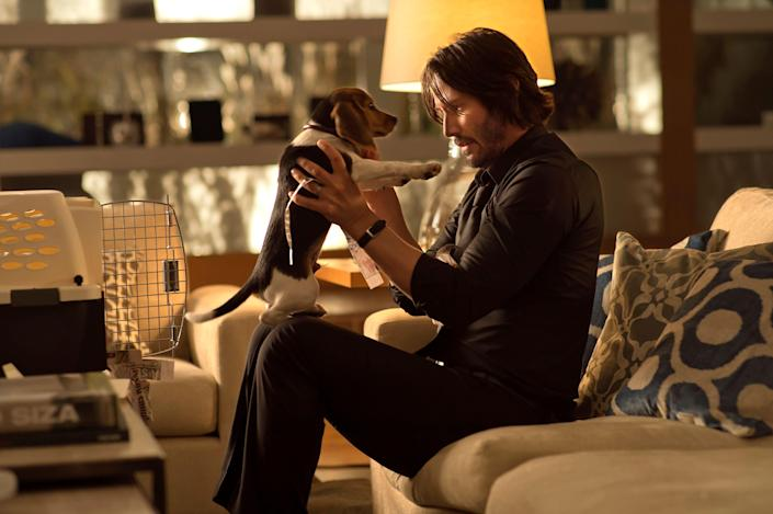 """Keanu Reeves' title character bonds with a beagle puppy before tragedy strikes in the original """"John Wick."""""""