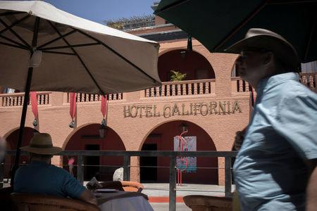 Tourists are seen in front of Hotel California in the town of Todos Santos