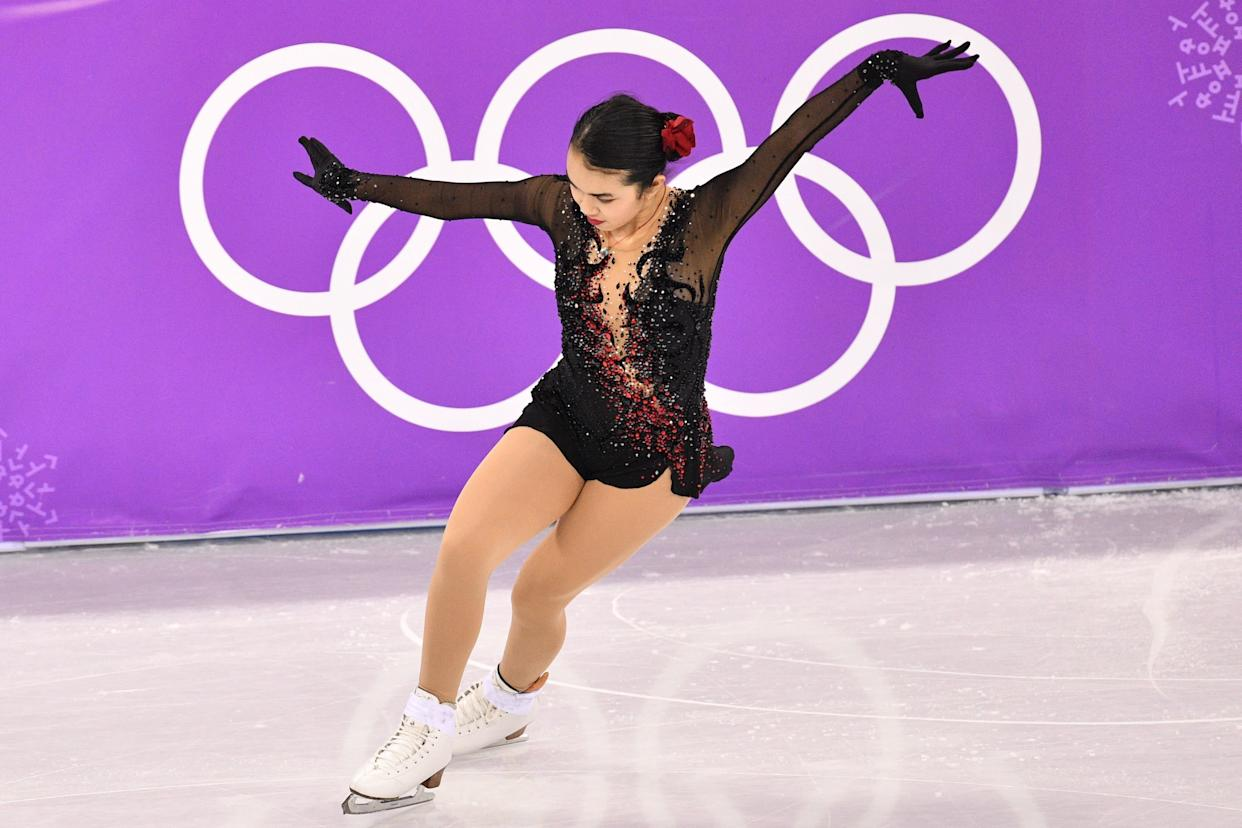 Chen, of the U.S., brought the drama in this lovely black costumewith red accent sparkles, which she wore for her free skate. Bonus points for the flower in the hair.