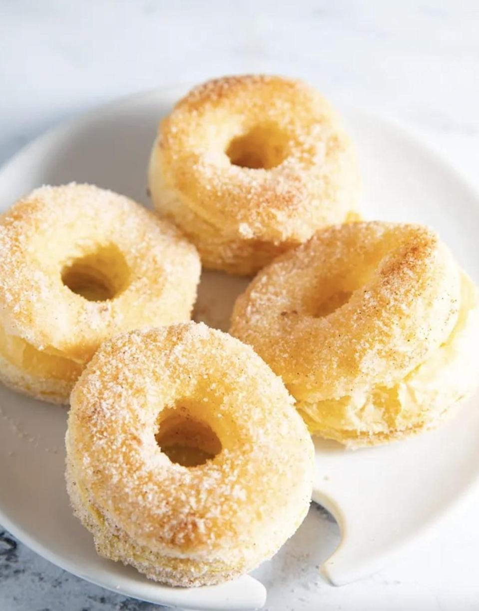 """<p>These five-ingredient donuts are about to become your go-to dessert. Flaky, puffy, and deliciously sweet, these donuts are sure to be a fan favorite. Dip them in melted butter and dust them in a cinnamon and sugar mixture to make them absolutely drool-worthy.</p> <p><strong>Get the recipe</strong>: <a href=""""https://www.myforkinglife.com/flaky-air-fryer-donuts/"""" class=""""link rapid-noclick-resp"""" rel=""""nofollow noopener"""" target=""""_blank"""" data-ylk=""""slk:air fryer donuts"""">air fryer donuts</a></p>"""