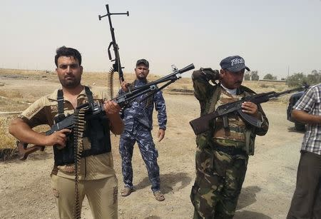 Members of Iraqi security forces and tribal fighters take part in an intensive security deployment on the outskirts of Diyala province June 13, 2014. REUTERS/Stringer