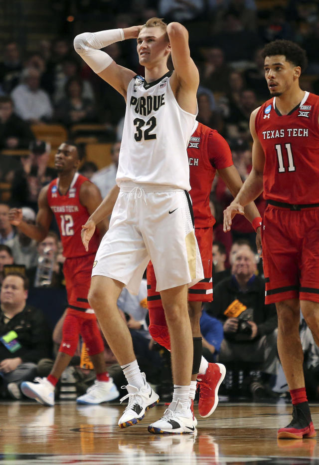Purdue's Matt Haarms reacts to a play next to Texas Tech's Zach Smith (11) during the second half of an NCAA men's college basketball tournament regional semifinal, early Saturday, March 24, 2018, in Boston. (AP Photo/Mary Schwalm)