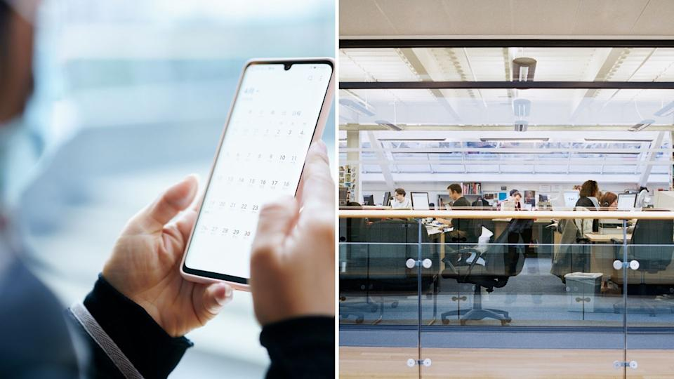 Hands holding phone with calendar app open, busy open plan office.