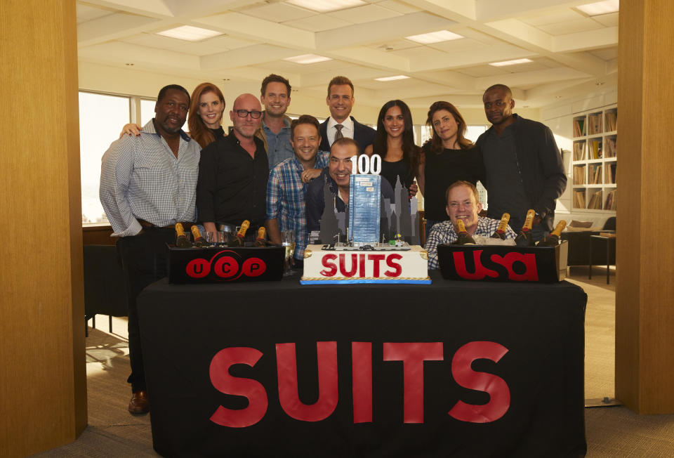 SUITS -- 100th Episode Celebration -- Pictured: (l-r) Wendell Pierce, Sarah Rafferty, Mark Binke (Executive Vice President, Production, Universal Cable Productions), Patrick J. Adams, Rick Muirragui (Executive Producer), Gabriel Macht, Rick Hoffman, Meghan Markle, Silver Tree (Executive Producer), Bill McGoldrick (Executive Vice President, Scripted Content, NBCUniversal Cable Entertainment), Dulé Hill -- (Photo by: Shane Mahood/USA Network/NBCU Photo Bank/NBCUniversal via Getty Images)