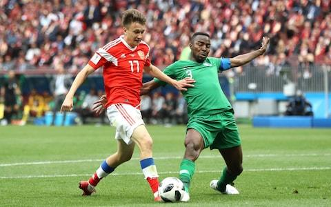 Aleksandr Golovin of Russia is challenged fairly in the area by Osama Hawsawi of Saudi Arabia - Credit: Ryan Pierse/Getty Images