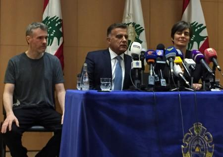 Canadian citizen, Kristian Lee Baxter, who was being held in Syria, sits next to Major General Abbas Ibrahim, Lebanon's internal security chief, after being released, at a news conference in Beirut