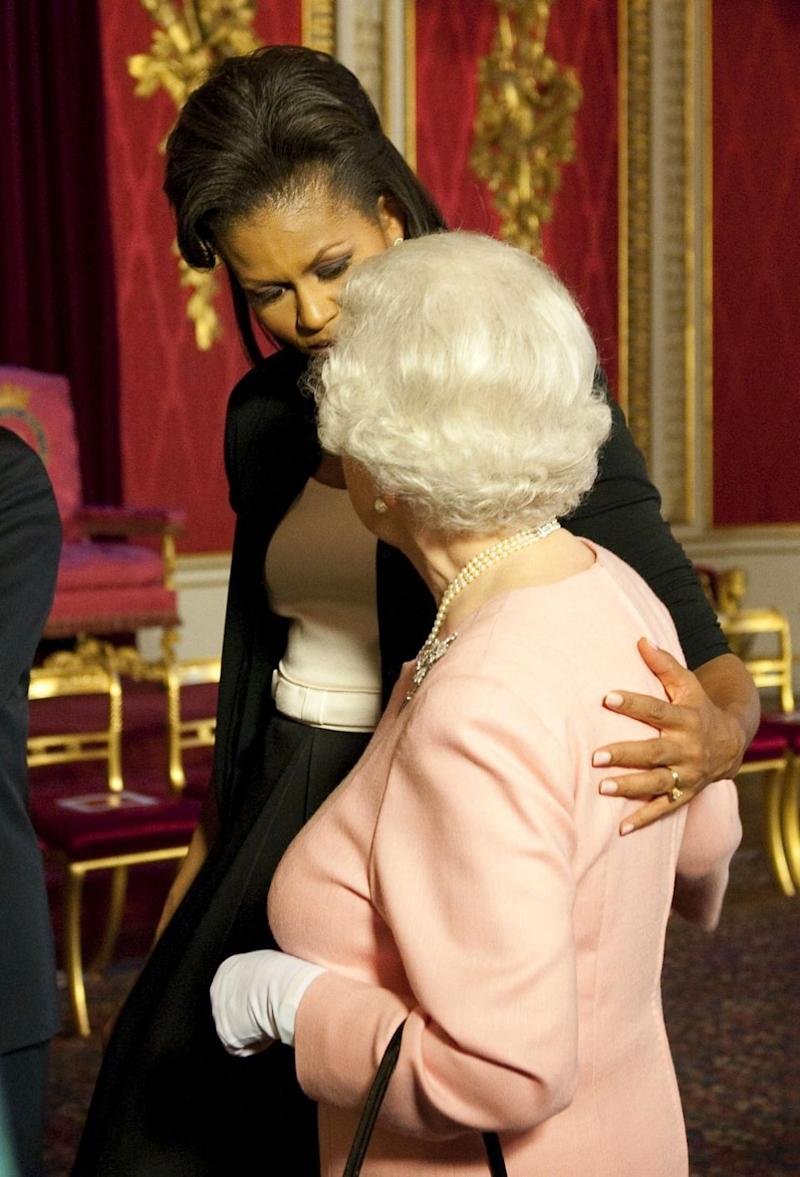 Michelle Obama's hand on the Queen's back also made headlines. Photo: Getty