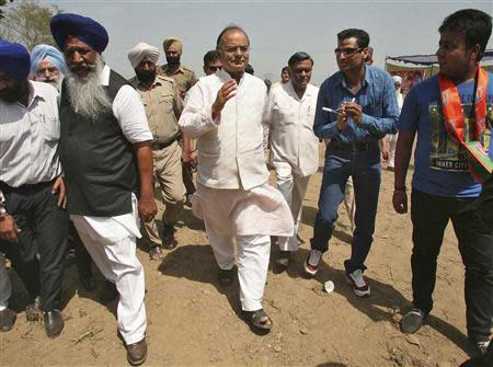 Arun Jaitley, a senior leader of India's main opposition Bharatiya Janata Party (BJP), greets his party's supporters as he arrives to attend an election campaign rally in his constituency in the northern Indian city of Amritsar April 11, 2014. REUTERS/Munish Sharma