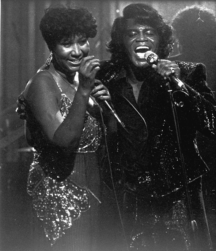 Performing with James Brown at the Taboo nightclub in Detroit in 1987.