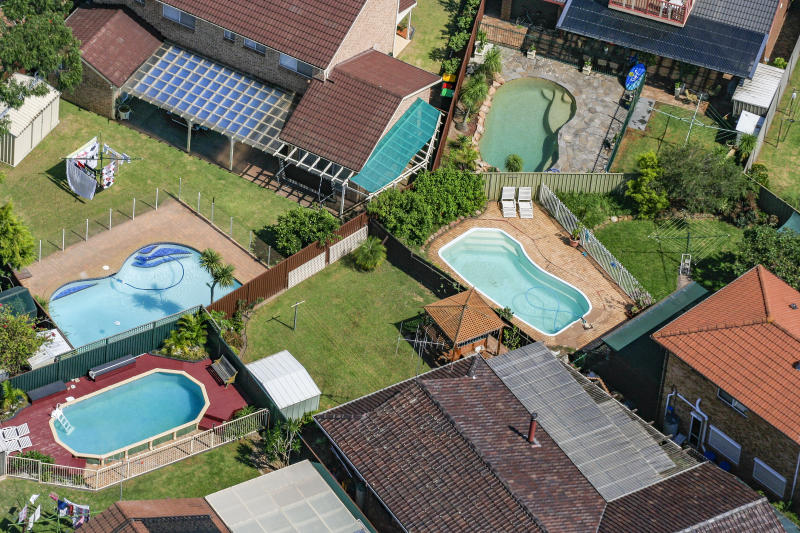 An aerial picture of pools in backyards in Australia.