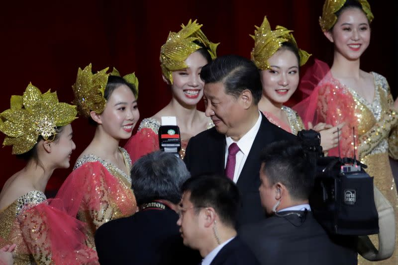 Chinese President Xi Jinping smiles at the performers on the stage during a cultural performance in Macau