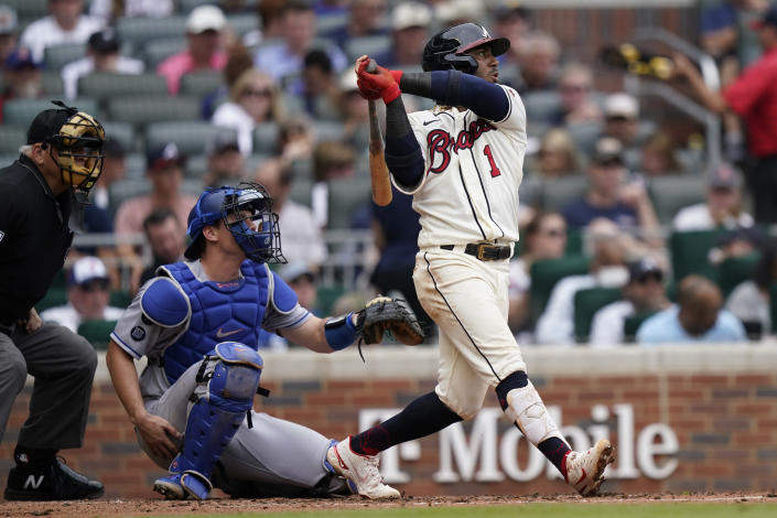 Atlanta Braves second baseman Ozzie Albies (1) drives in a run with a double as Los Angeles Dodgers catcher Will Smith (16) looks on in the third inning of a baseball game Sunday, June 6, 2021, in Atlanta. (AP Photo/Brynn Anderson)