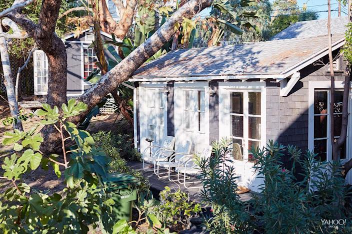 <p>A view of my husband's office in our backyard; he built it himself to match the house. The doors were recovered from a house in Beverly Hills.</p>