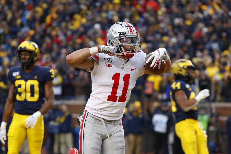 Ohio State wide receiver Austin Mack (11) celebrates after scoring on a 16-yard touchdown reception against Michigan in the second half of an NCAA college football game in Ann Arbor, Mich., Saturday, Nov. 30, 2019. (AP Photo/Paul Sancya)