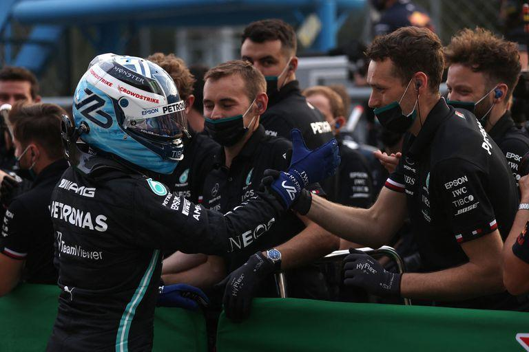 Mercedes' Finnish driver Valtteri Bottas greets members of his team in the parc ferme after the qualifying sessions at the Autodromo Nazionale circuit in Monza, on September 10, 2021, ahead of the Italian Formula One Grand Prix. (Photo by LARS BARON / various sources / AFP)