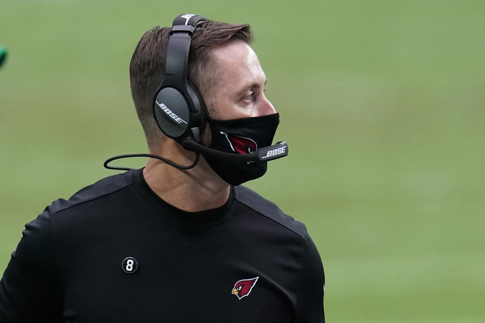 Arizona Cardinals head coach Kliff Kingsbury watches during the first half of an NFL football game against the Detroit Lions, Sunday, Sept. 27, 2020, in Glendale, Ariz. (AP Photo/Ross D. Franklin)