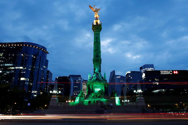 Green lights are projected at the Angel of Independence monument in Mexico City, Mexico.