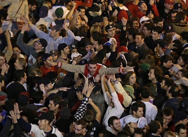 Boston Red Sox fans celebrate after Boston defeated St. Louis Cardinals in Game 6 of baseball's World Series Wednesday, Oct. 30, 2013, in Boston. The Red Sox won 6-1 to win the series. (AP Photo/Charlie Riedel)
