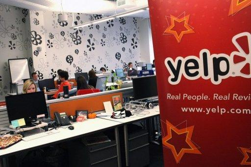 Employees of the online review site Yelp are seen at the East Coast headquarters