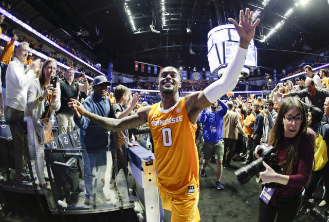 Tennessee guard Jordan Bone (0) celebrates as he leaves the court after Tennessee beat Kentucky 82-78 in an NCAA college basketball game at the Southeastern Conference tournament Saturday, March 16, 2019, in Nashville, Tenn. (AP Photo/Mark Humphrey)