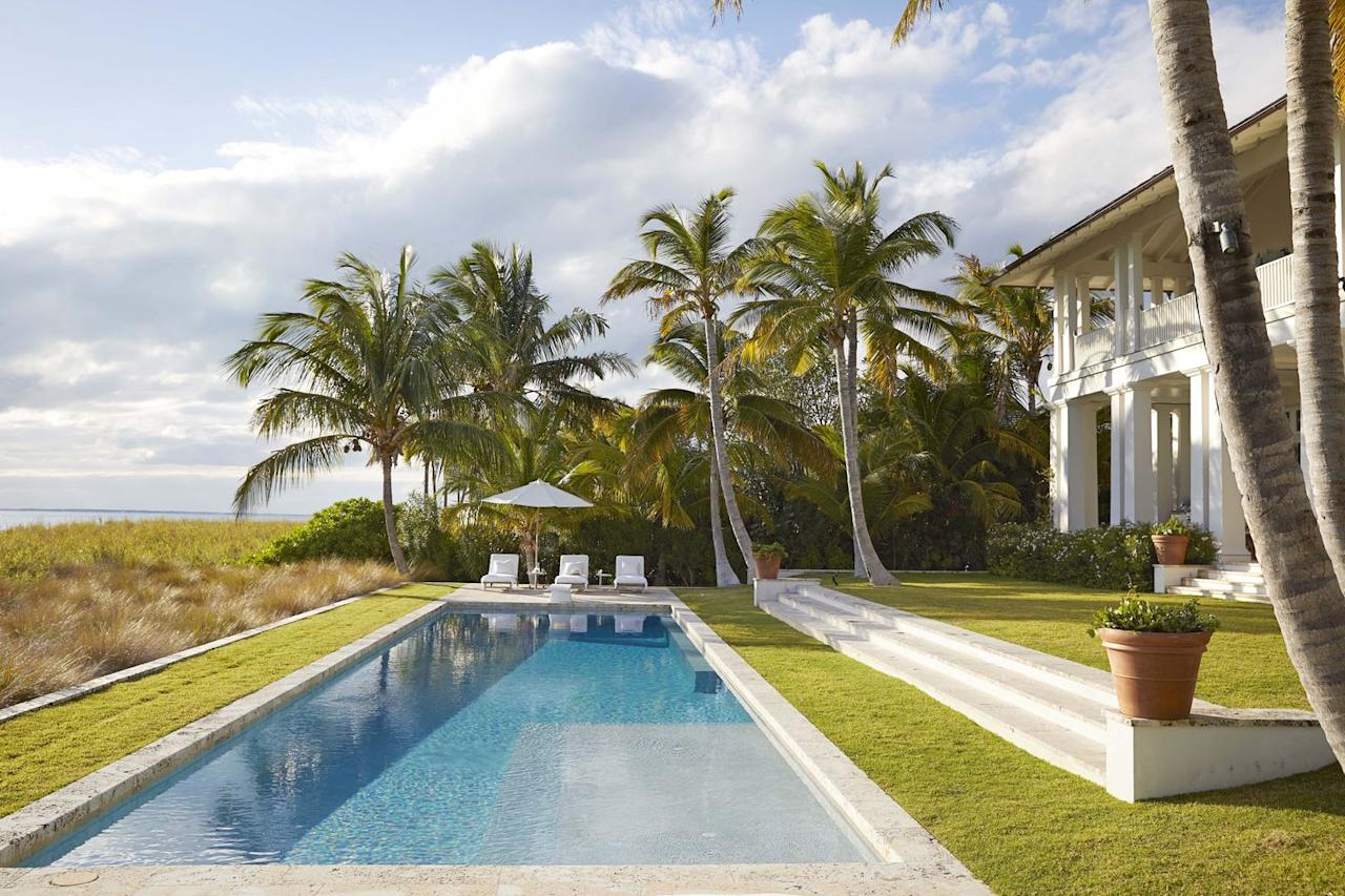 "<p>A terraced lawn with sets this simple, sophisticated rectangular swimming pool apart from the Bahamas Estate designed by <a href=""https://reddkaihoi.com/"" target=""_blank"">Miles Redd</a>. A screen of palms at each end of the pool provides privacy. </p>"