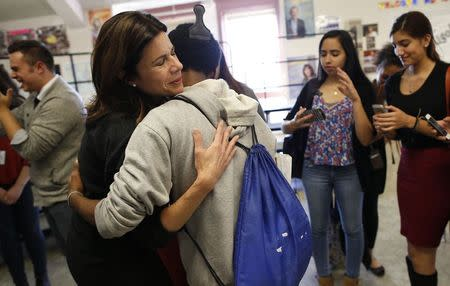 Opera singer Ana Maria Martinez hugs a student during a visit at Lake View High School in Chicago, Illinois, October 22, 2014. REUTERS/Jim Young