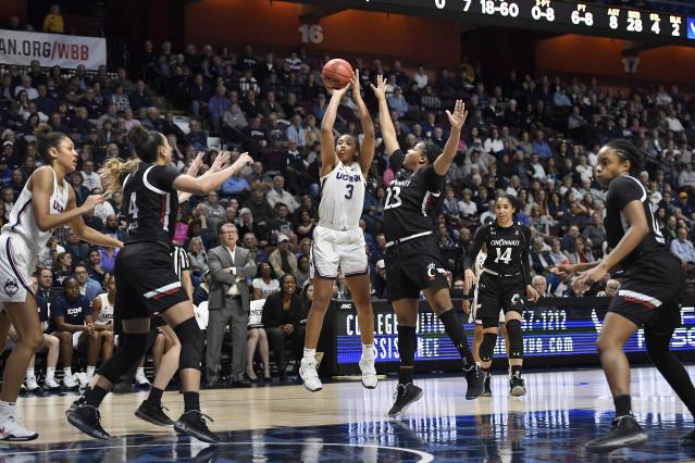 Connecticut's Megan Walker (3) shoots over Cincinnati's IImar'I Thomas (23) in the second half of an NCAA college basketball game in the American Athletic Conference tournament finals at Mohegan Sun Arena, Monday, March 9, 2020, in Uncasville, Conn. (AP Photo/Jessica Hill)