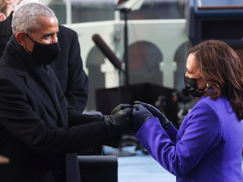Barack Obama, America's first Black president, fist-bumps Kamala Harris, the first Black vice presidentEPA