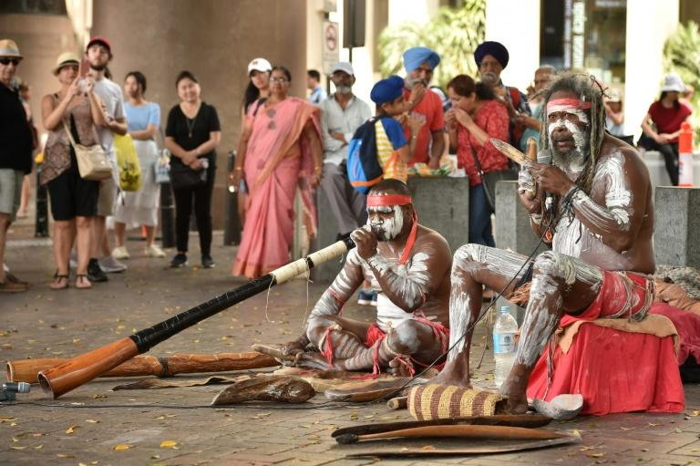 Indigenous Australians performing in Sydney on Australia Day, which celebrates the origins of the modern nation. Many indiginous Australians, however, mark the day with mourning (AFP Photo/PETER PARKS)