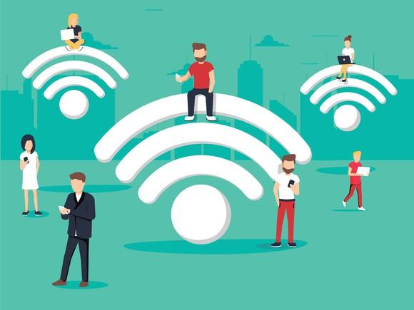 Three huge, cartoon-style WiFi symbols hang in the air. Seven equally cartoonish characters stand or sit around them, using mobile devices and laptops