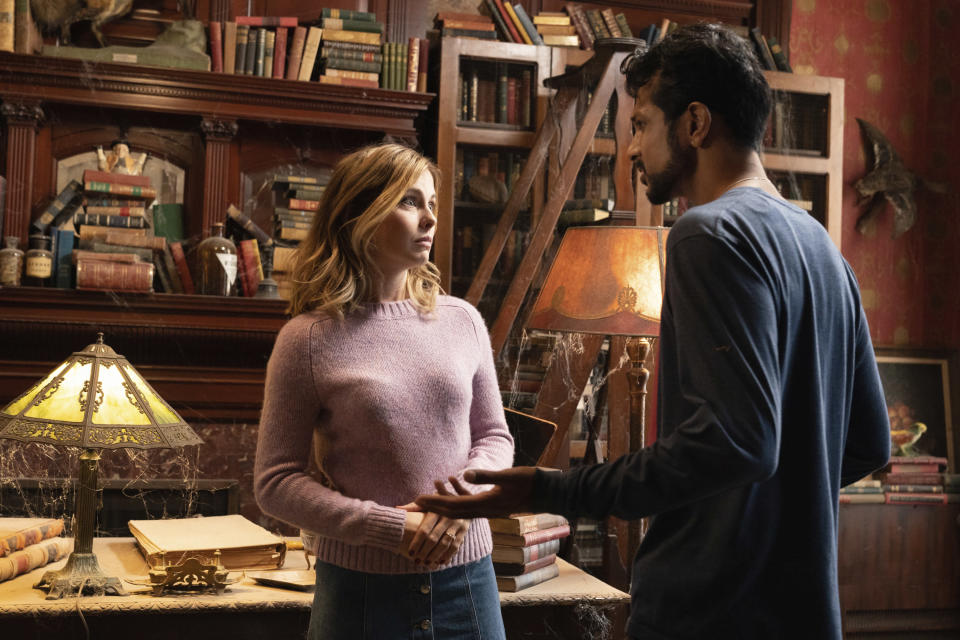 """This image released by CBS shows Rose McIver, left, and Utkarsh Ambudkar in a scene from the comedy series """"Ghosts."""" (Cliff Lipson/CBS via AP)"""