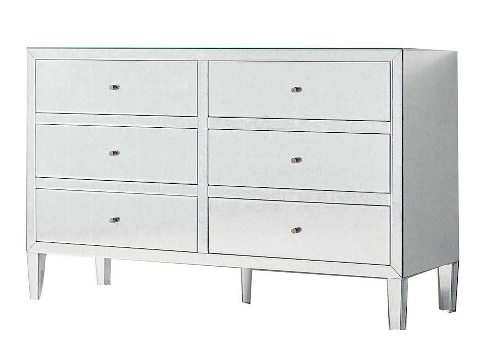 """<p><strong>Jean Liu:</strong> The mirrored finish is great for reflecting light in smaller spaces. </p><p><strong>James Huniford:</strong> The piping along the borders adds visual interest. Lean into the design of this piece with an upholstered white bed and white curtains.</p><p><em>60"""" w. x 20"""" d. x 36"""" h.; $2,699. <a href=""""https://rh.com/"""" rel=""""nofollow noopener"""" target=""""_blank"""" data-ylk=""""slk:rh.com"""" class=""""link rapid-noclick-resp"""">rh.com</a></em></p>"""
