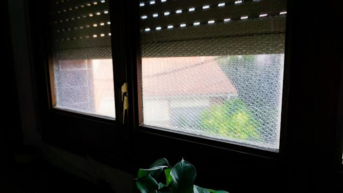 Window glass lined with bubble wrap stock photo