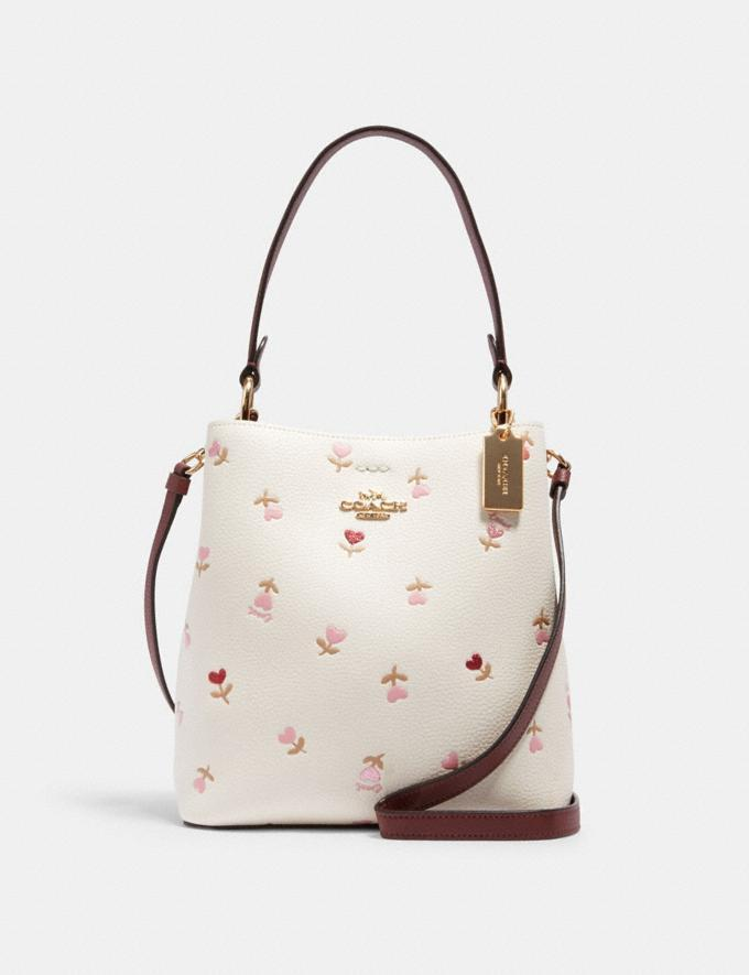 Small Town Bucket Bag With Heart Floral Print. Image via Coach Outlet.