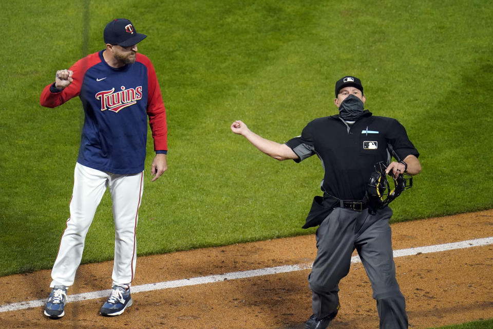 Minnesota Twins manager Rocco Baldelli, left, is ejected by home plate umpire Jim Reynolds after complaining about the ejection of pitcher Tyler Duffey in the seventh inning of the team's baseball game against the Chicago White Sox on Tuesday, May 18, 2021, in Minneapolis. (AP Photo/Jim Mone)