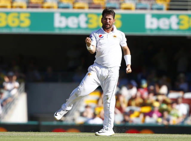 Pakistan's Yasir Shah celebrates getting the wicket of Australia's Josh Hazlewood during their cricket test match in Brisbane, Australia, Saturday, Nov. 23, 2019. (AP Photo/Tertius Pickard)